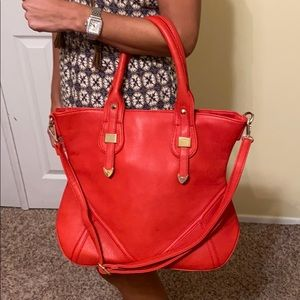 Red purse with gold accents NWOT